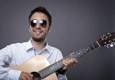 Handsome young man playing guitar Royalty Free Stock Images