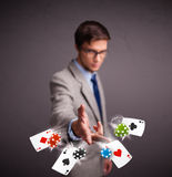 Young man playing with poker cards and chips Royalty Free Stock Images
