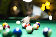 Young man playing pool in pub royalty free stock images