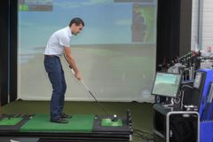 Handsome young man playing virtual golf. Man Royalty Free Stock Images