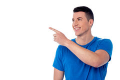 Handsome young man pointing away Royalty Free Stock Photography