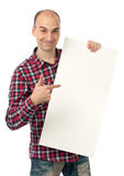 Handsome young man pointing at a blank billboard Stock Photo