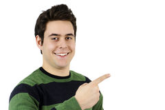 Handsome young man pointing at blank space Royalty Free Stock Photography