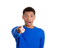 Handsome young man pointing at the camera in shock and astonishment Royalty Free Stock Image