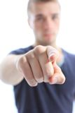 Handsome young man pointing finger Stock Images