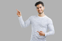 Handsome young man pointing Stock Image