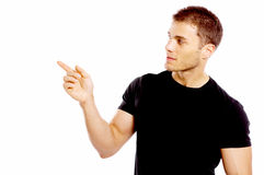 Handsome young man pointing to the side Royalty Free Stock Image