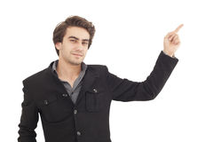 Handsome young man pointing to somewhere Stock Photography