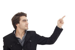 Handsome young man pointing to somewhere Stock Image