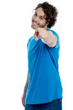 Handsome young man pointing towards camera Royalty Free Stock Photo