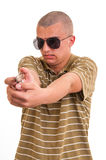 Handsome young man pointing with toy gun Stock Photos
