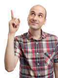 Handsome young man pointing up Royalty Free Stock Images