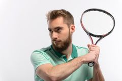 Handsome young man in polo shirt holding tennis Stock Image