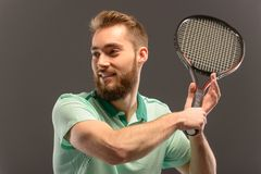 Handsome young man in polo shirt holding tennis Stock Photo