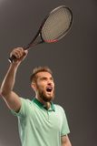 Handsome young man in polo shirt holding tennis Royalty Free Stock Image