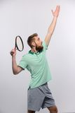 Handsome young man in polo shirt holding tennis Royalty Free Stock Photography