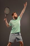 Handsome young man in polo shirt holding tennis Royalty Free Stock Photos