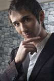 Handsome young man portrait in black suit Royalty Free Stock Images