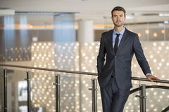 Portrait of a Handsome Young Executive at an Upscale Hotel Stock Images