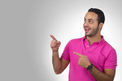 Handsome young man portrait pointing his fingers Stock Photography