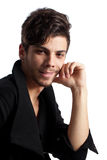 Handsome young man posing. Portrait of a young man with cool hairstyle looking at camera. Isolated on white background. Studio vertical image Stock Photography