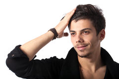 Handsome young man posing. Portrait of a young man with cool hairstyle. Isolated on white background. Studio horizontal image Royalty Free Stock Images