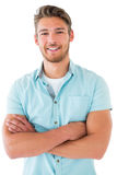 Handsome young man posing with arms crossed Stock Images