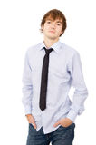 The handsome young man posing in front of the camera, in a shirt Royalty Free Stock Images