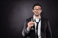 Handsome young man posing with glass of champagne stock photos
