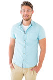 Handsome young man posing with hands in pockets Royalty Free Stock Photo