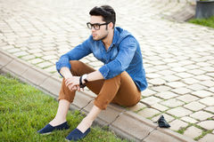 Handsome young man posing outdoors Stock Images
