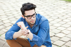 Handsome young man posing outdoors Stock Image