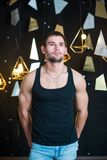 Handsome man in black tank top, posing, fashion portrait. Handsome young man posing in studio, model photo Royalty Free Stock Images