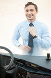 Handsome young man is preparing to drive public Stock Photos