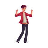 Handsome young man raising hands in happiness and excitement Stock Photography