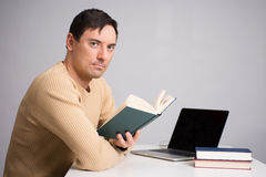 Handsome young man reading a book Royalty Free Stock Photo