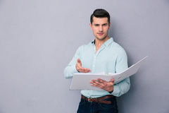 Handsome young man reading documents Stock Photo