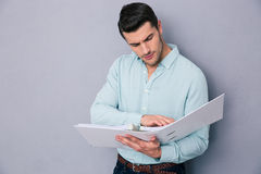 Handsome young man reading documents Royalty Free Stock Photo