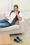Handsome young man reading good book Stock Image
