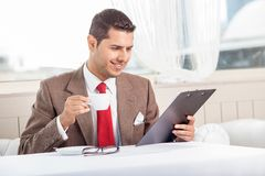 Handsome young man is reading some documents royalty free stock photos