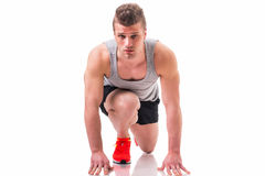 Handsome young man, ready for a sprint and run Royalty Free Stock Photos