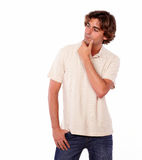 Handsome young man reflecting alone while standing Stock Photos