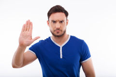 Handsome young man is refusing to do something Stock Images