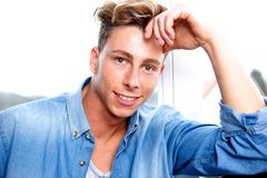 Handsome young man relaxing Stock Images