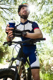 Handsome young man relaxing after cycling in the mountain. Royalty Free Stock Images