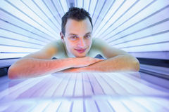 Handsome young man relaxing  in a  solarium Royalty Free Stock Images