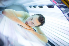 Handsome young man relaxing  in a  solarium Stock Photography