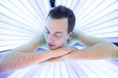 Handsome young man relaxing  in a  solarium Royalty Free Stock Photography