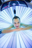 Handsome young man relaxing  in a solarium Stock Photos