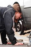 Handsome young man repairing car Stock Photo